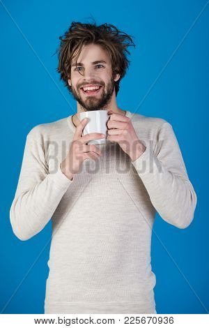Insomnia, Refreshment And Energy. Happy Guy With Tea Cup On Blue Background. Cold And Flu, Single. M
