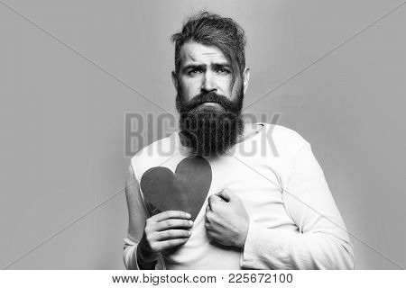 Young Bearded Man With Sad Face Holding Red Paper Heart In Studio On Grey Background, Copy Space