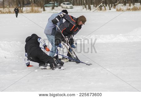 Dnipro, Ukraine - January 27, 2018: Three Mature Amateur Men Fighting For The Puck While Playing Hoc