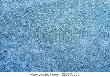 Abstract Natural Background - Ice Pattern On A Water Surface At Winter Season