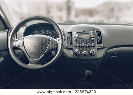 The Image Car Inside Driver Place. Interior Of Modern Car.e Steering Wheel, Dashboard, Display Clima