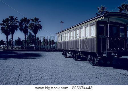 Retro Wooden Railway Carriage At Old Station Of Tel Aviv At Night. Israel Historic Train On The Line