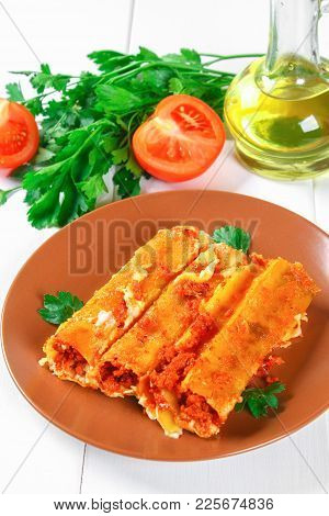 Traditional Italian Pasta Cannelloni. Baked Tubes Stuffed With Minced Meat With Parmesan Cheese And