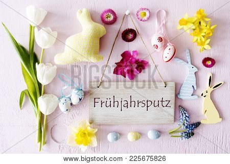 Wooden Sign With German Text Fruhejahrsputz Means Spring Cleaning. Easter Flat Lay With Decoration L
