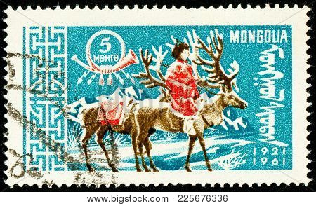 Ukraine - Circa 2018: A Postage Stamp Printed In Mongolia Show Postman On Reindeer Or Rangifer Taran