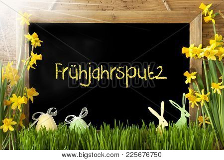Blackboard With German Text Fruehjahrsputz Means Spring Cleaning. Sunny Spring Flowers Nacissus Or D