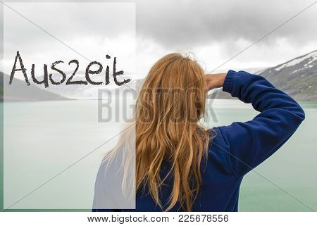German Text Auszeit Means Downtime. Caucasian Woman Enjoys The View To A Glacier In Norway. Lake Or