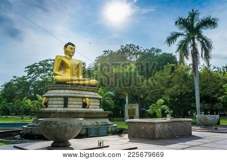 The Golden Buddha Statue In The Viharamahadevi Park In The Center Of Colombo, The Capital Of Sri Lan