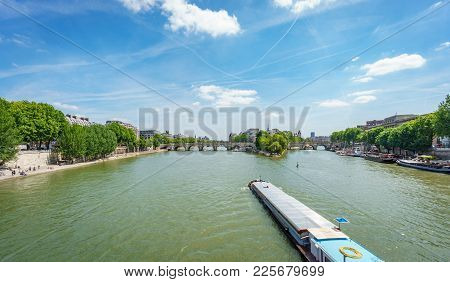 Wide Angle Panoramic View Of Large Boat Over Seine River Entering Notre Dame Island, Paris
