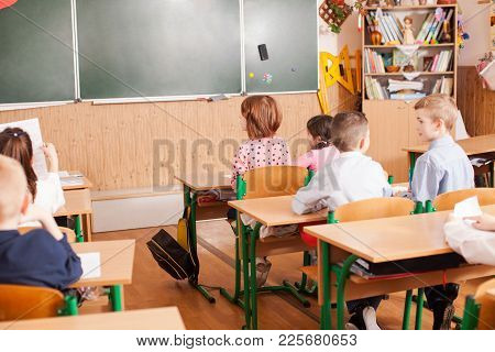 Children Of Primary School Taking An Exam Writing School Test