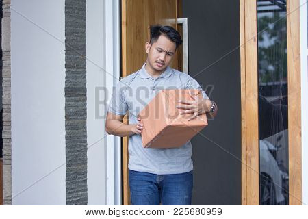 Man Recieve A Delivery Box At Home