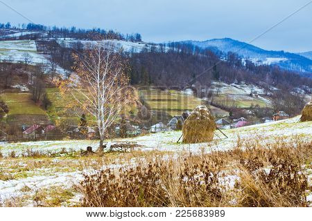 Autumn And Winter Are Meeting On The Fields. Pastoral Landscape