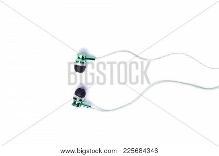 Earphones On White Background, Concept Of Music Sound
