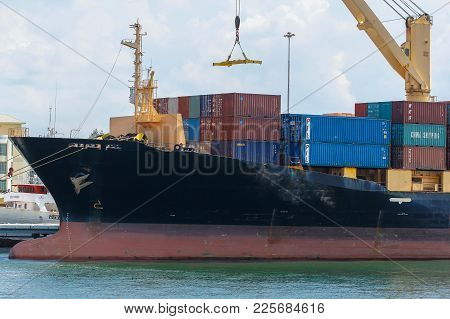 Labuan,malaysia-feb 2,2018:china Cargo Containers On Shipping Containers At Labuan Port,malaysia.chi