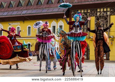 Debrecen, Hungary - August 20, 2017: Carnival Dancers On Stilts Performs During The 48th Flower Carn