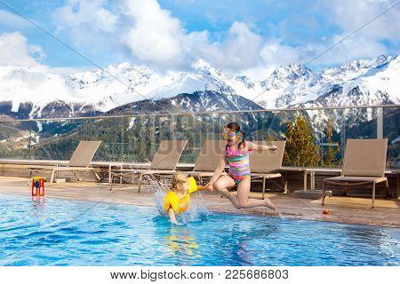 Kids In Outdoor Swimming Pool Of Alpine Resort