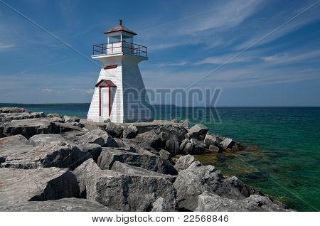 Lighthouse on a Rocky Breakwall