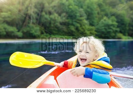 Child On Kayak. Kids On Canoe. Summer Camping.