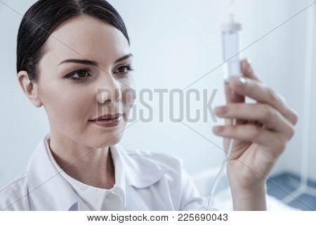 Always Ready To Help. Selective Focus On A Young Woman Working In A Hospital Smiling While Adjusting