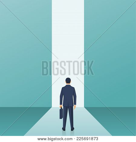Entrance Concept. Way Forward Businessman In Suit Stands In Front Of Door In Wall. Look Into Future.