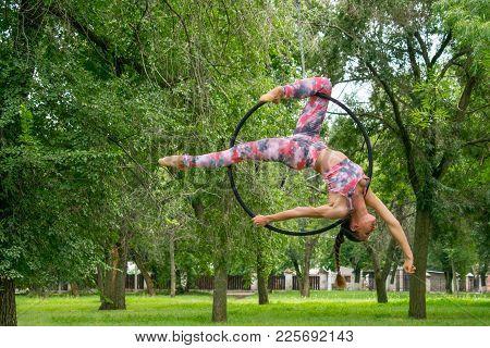 Kropivnitskiy, Ukraine - 29 Jule, 2017: Girl Gymnast On Acrobatic Circus Ring Shows Elements Of Pole