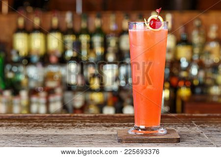 Strawberry Cocktail With Gin, Cherry, Lemon Zest And Lemon Juice In A Highball Glass