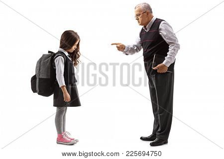 Full length profile shot of an old teacher scolding a schoolgirl isolated on white background