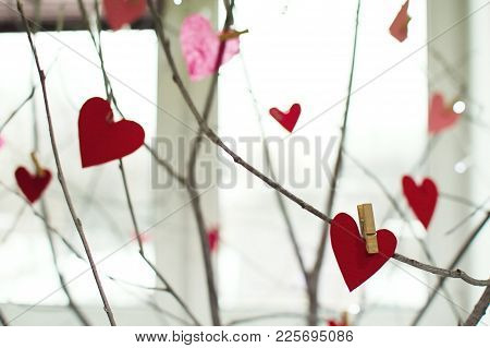 Red Heart Paper Cut With Clothes Pin On Wooden Branches. Image Of Valentines Day. Red, Pink Colors