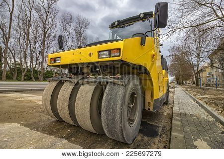 Close View On The Road Roller. Street Paving Works