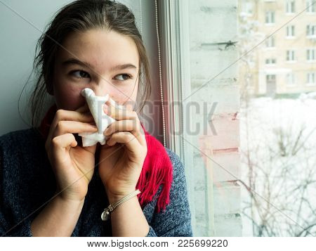 teenage girl with a cold handkerchief