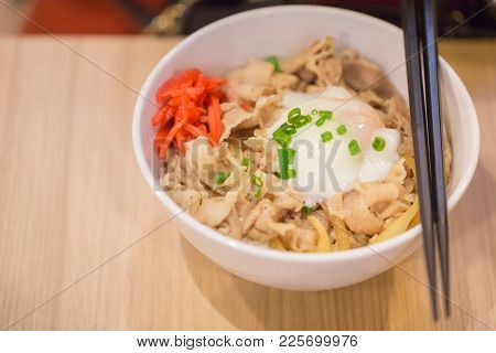Japanes Food Gyudon Or Butadon With Onsen Tamago Egg Lunch Meal On Wood Table