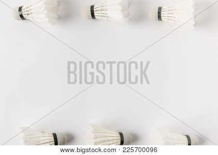 Top View Of Frame Made Of Badminton Shuttlecocks On White Surface
