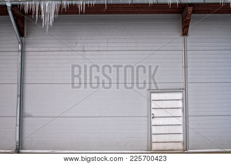 An Old Door In The Steel Wall In The Small Rural Town Of Oulainen In The Northern Finland. The Sprin