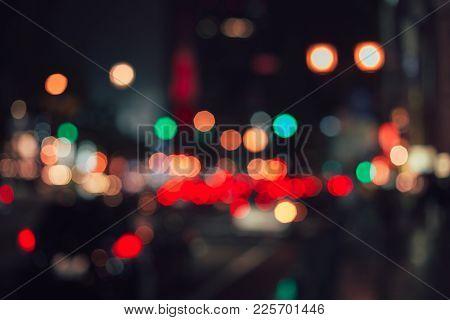 Beautiful Night Light And Colorful Bokeh In Urban City Street Road.