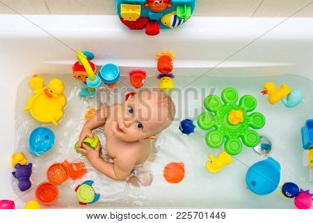 Baby Boy Taking A Bath, Playing With Colorful Toys