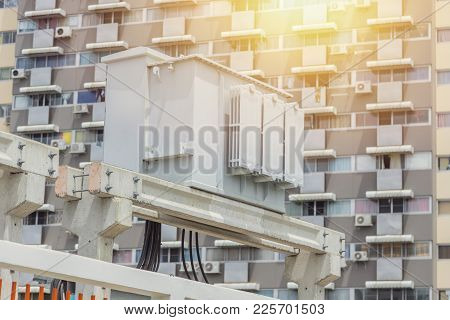 Electricity Transformer With Accommodation Apartment Community Building Background.