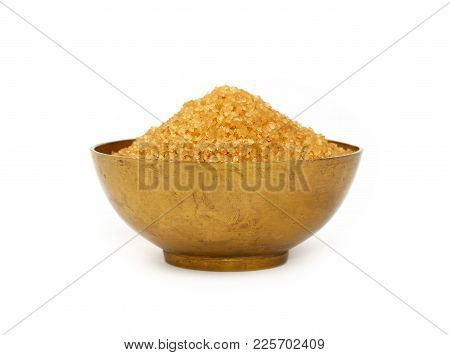 Close Up One Vintage Bronze Metal Bowl Full Of Raw Brown Cane Sugar, Isolated On White Background, L