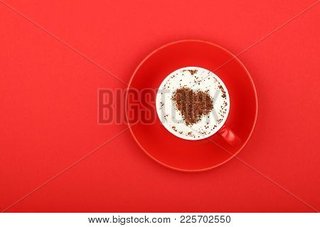 Close Up One Latte Cappuccino Coffee With Heart Shaped Chocolate Milk Topping In Red Cup With Saucer