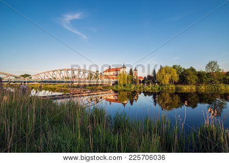 View At Bridge Over The Narew River And Baroque Church Of The Holy Trinity In Tykocin Town, Podlasie