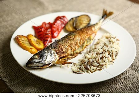 Healthy And Proper Food, Grilled Fish And Vegetables With Lemon And Black And White Rice On A White