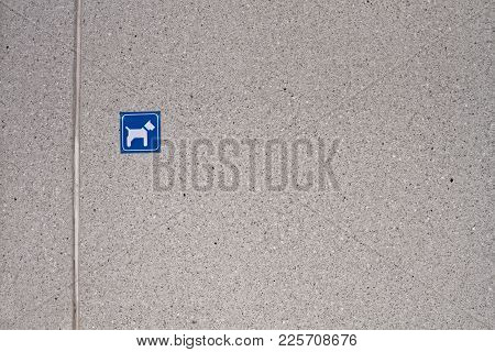 A Small Sign Showing The Dog Park Location On A Concrete Wall At A Small Town Of Oulainen In The Nor