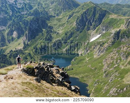 French Pyrenees, Female Hiker Overlooking A Lake