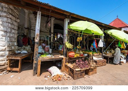 Stone Town, Tanzania - January 9, 2015: People Selling Fruit At Market Stalls In Stown Town, Tanzani