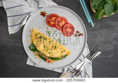 Delicious Omelet With Vegetables On A Plate.