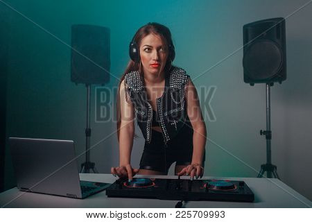 A Beautiful Girl Writes Music On A Dj Device