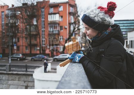 The Girl Is Playing On The Street With An Imaginary Dog, Which Is Actually A Lamp