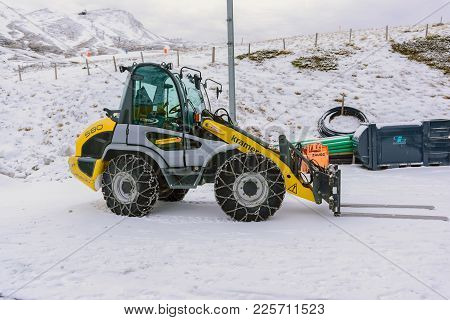 Jungfrau,switzerland-jan 4,2017: Snow Loader Require A Chain On The Wheel To Prevent Slipping When T
