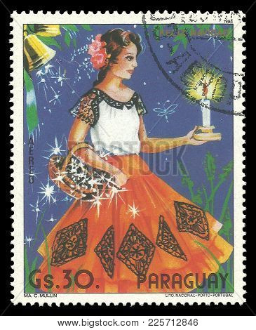 Paraguay - Circa 1984: Stamp Printed By Portugal, Color Edition On Christmas, Shows Woman With Candl