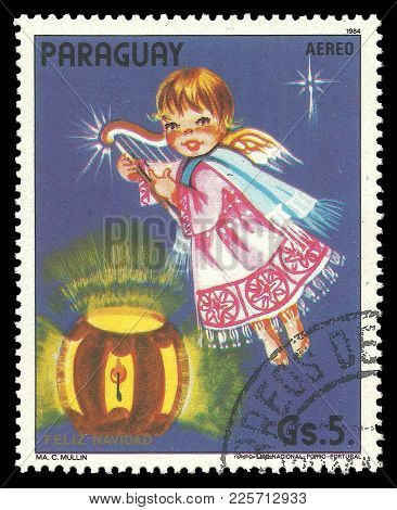 Paraguay - Circa 1984: Stamp Printed By Portugal, Color Edition On Christmas, Shows Angel A Musical