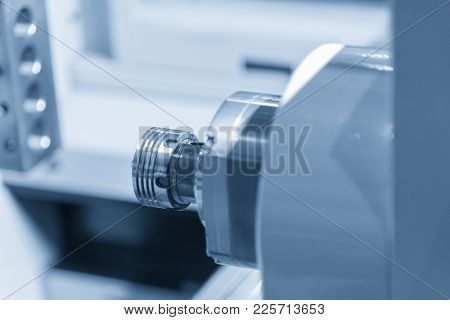 The Cnc Lathe Machine Cutting The Thread At The End Of The Pipe.the Water Pipe Manufacturing Process